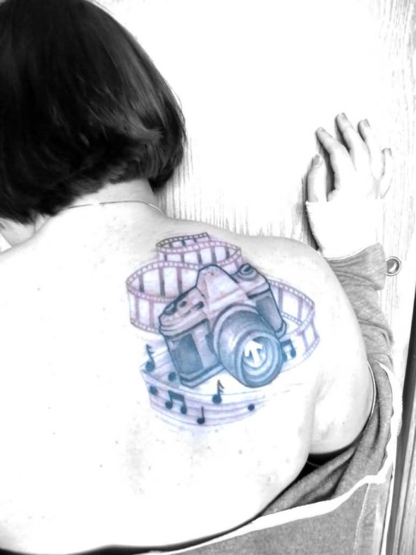 Pretty Girl Show  Film Camera And Famous Music Symbol Tattoo On  Back Shoulder 4