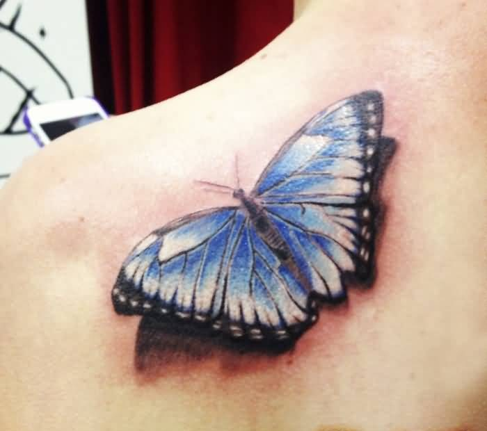 Tattoo Of Brilliant Butterful Sitting On Women's Back Shoulder 7