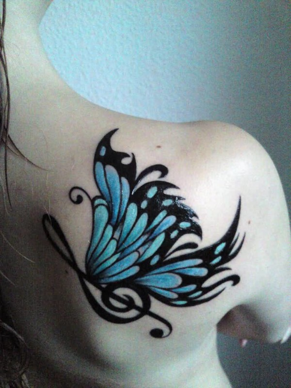 Wonderful Butterfly And Music Symbol Tattoo Design On Upper Back 6