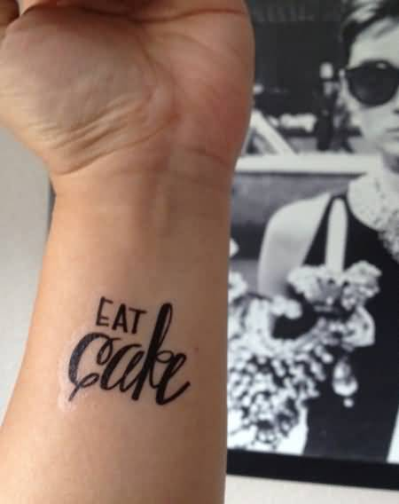 Wonderful Eat Cake Text Tattoo On Wrist 1