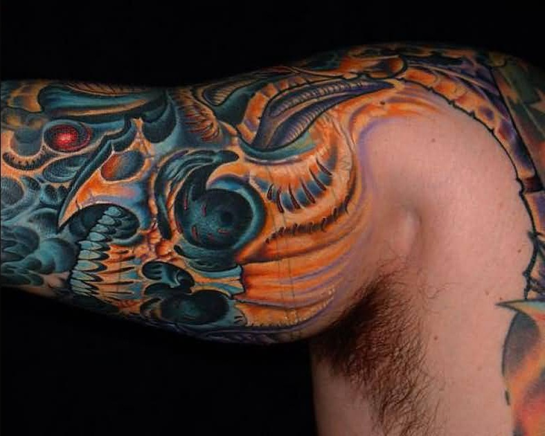 Young Men Show Biomechanical Scary Skull Tattoo On Sleeve7