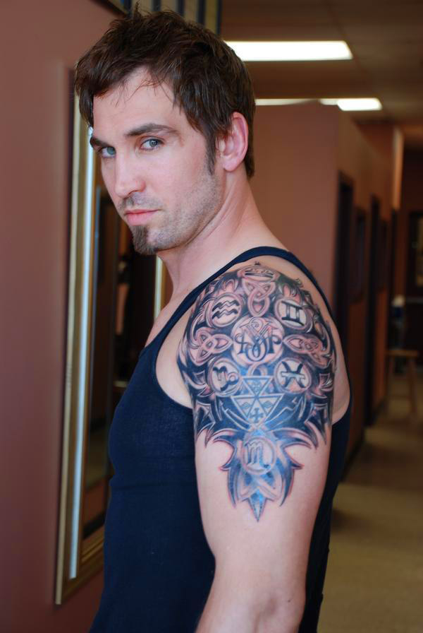 Beautiful Men Shows Family Crest Tattoo For Bicep
