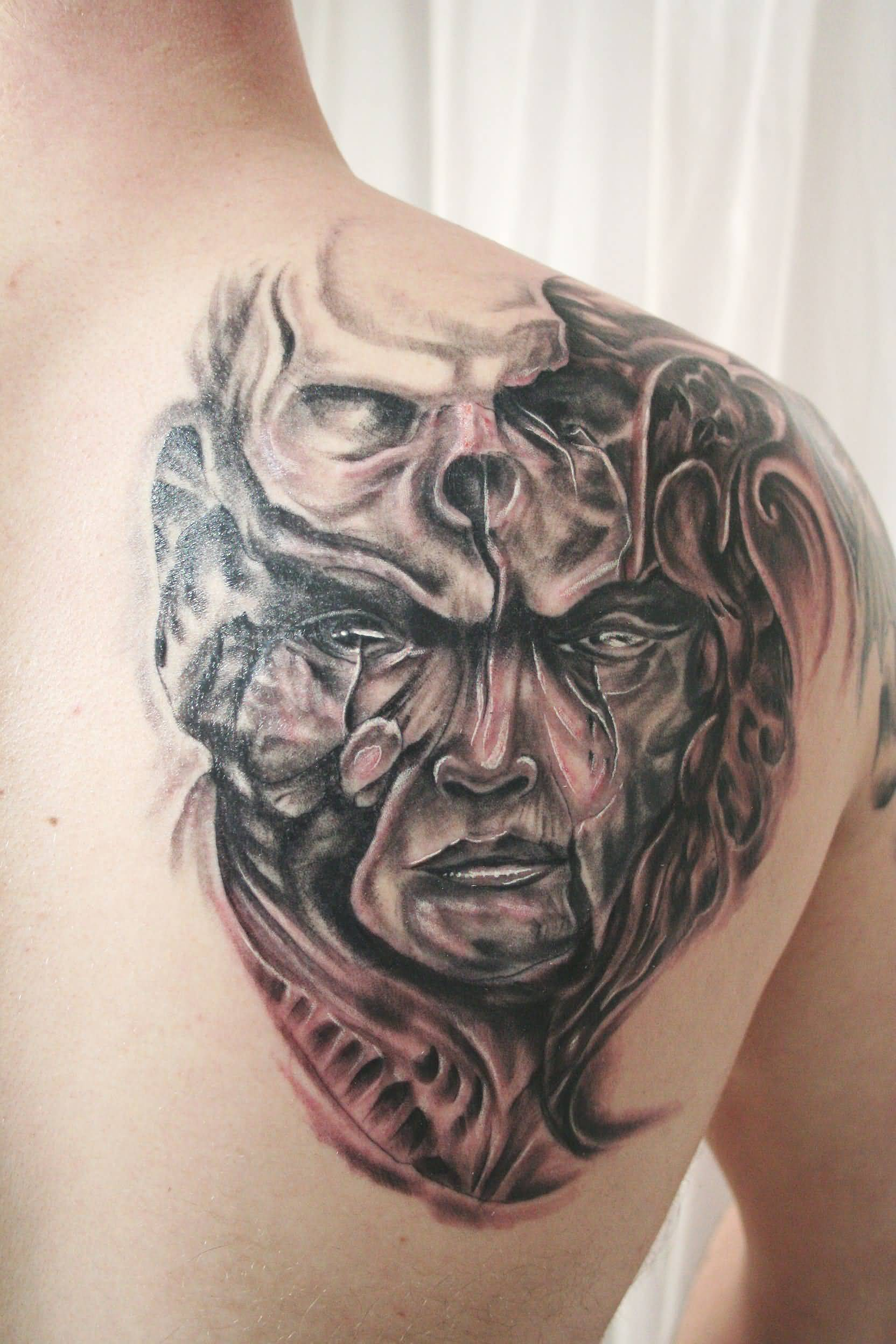 Fantastic Biomechanical Mask Tattoo On Back Shoulder
