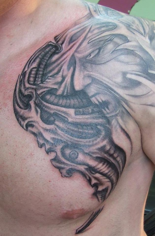 Fascinating Biomechanical Tattoo For Men's Chest