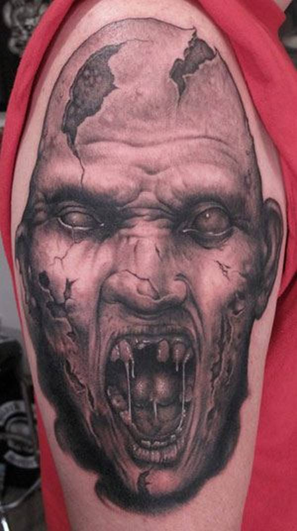 Groovy Monster Tattoo Design On Men's Bicep