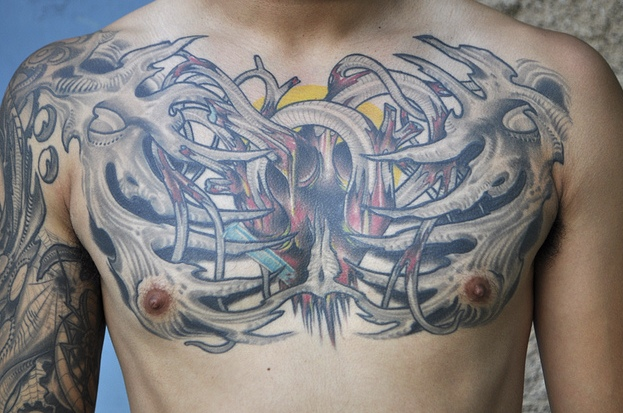 Biomechanical chest tattoo ideas and biomechanical chest for Chest cover up tattoos