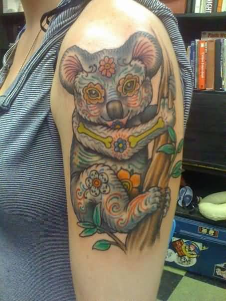 Sweet Baby Bear Hold Tree Tattoo Design On Bicep
