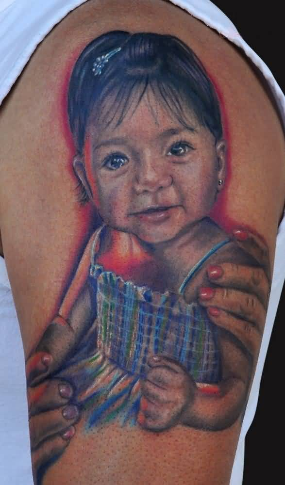 Tattoo Of Sweet Baby Girl Sitting On Men's Bicep