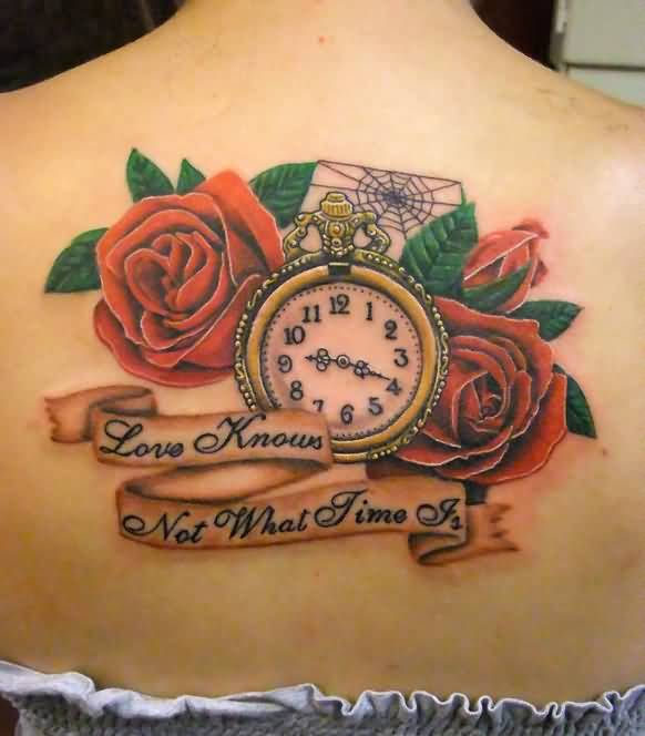 Attractive Women Show Brilliant Red Roses And Old Clock With Mind Blowing Banner Tattoo On Upper Back