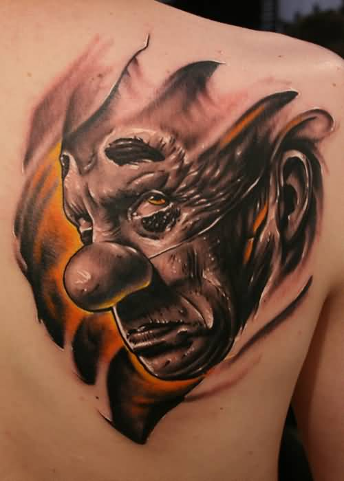 Brilliant Angry Sad Clown Tattoo Design For Side Back