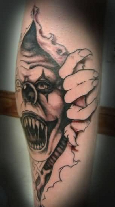 Brilliant Ripped Skin Amazing Open Mouth Angry Clown Tattoo