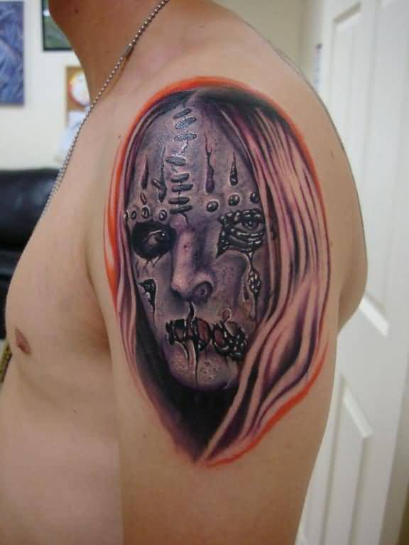 Brilliant Scary Clown Face Tattoo On Men's Upper Sleeve