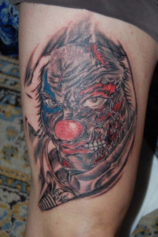 Dangerous Angry Clown Tattoo Design Make On Thigh