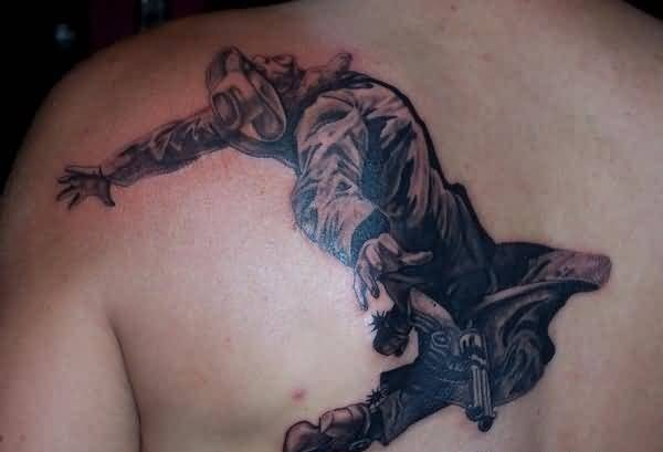 Dangerous Crawling Cowboy Soldier With Gun Tattoo On Upper Back