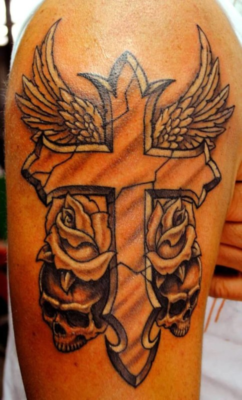 Fabulous Cross Wings With Beautiful Flowers And Skulls Tattoo On Upper Sleeve