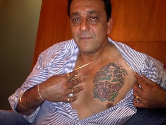 famous sanjay dutt show angel girl and lovely sunil writing tattoo on chest. Black Bedroom Furniture Sets. Home Design Ideas