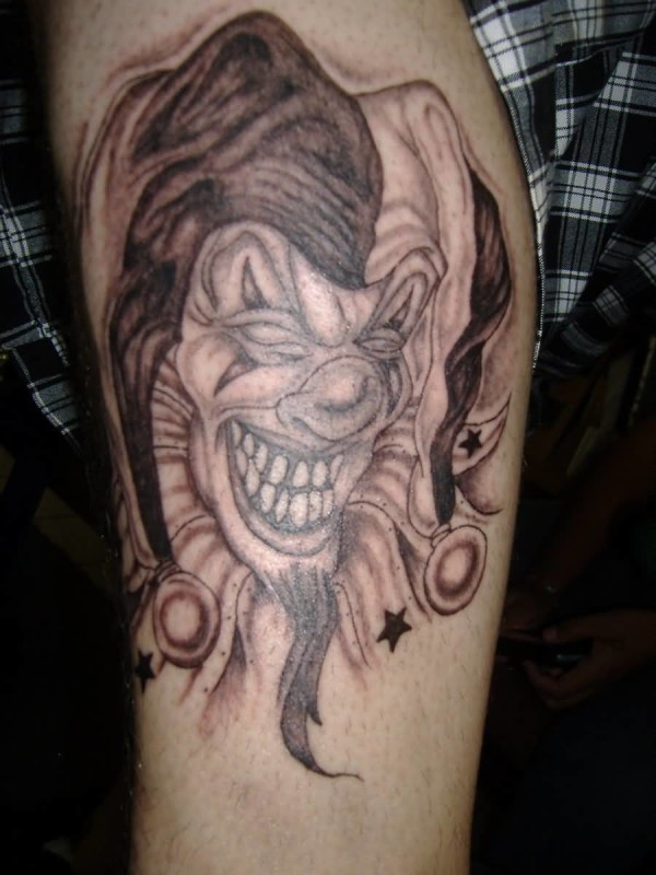 Handsome Men Show Outstanding Clown Head Tattoo Design