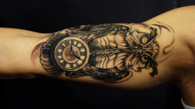 Brilliant Biomechanical Owl And Tiny Clock Tattoo For Bicep