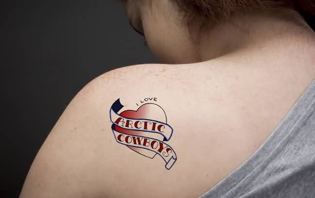 Latest arctic Cowboy Banner And Red Heart Tattoo Design Make On Upper Back