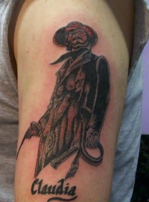 Lovely Claudia Word And Dangerous Skull Cowboy Hold Big Gun Tattoo On Upper Sleeve