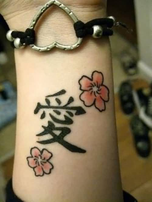 Lovely Flower And Black Chinese Symbol Tattoo On Wrist