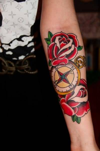Lovely Red Flowers And Traditional Old Compass Tattoo On Lower Sleeve