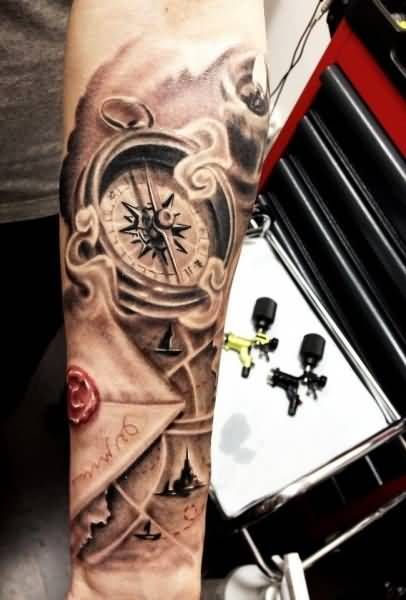 Lower Sleeve Decorated With Realistic Compass Tattoo Design Made By Ink