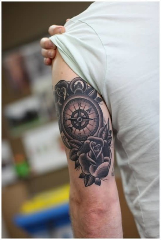Marvelous Compass In Circle With Nice Looking Lovely Flower Tattoo Made By Ink