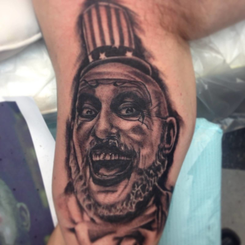Men Upper Sleeve Decorated With Crazy Open Mouth Cown Tattoo