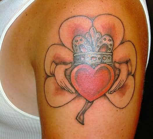 Men Upper Sleeve Decorated With Orchid Claddagh Tattoo