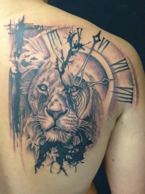 Mind Blowing Dangerous Lion Face Clock Tattoo On Men's Side Back