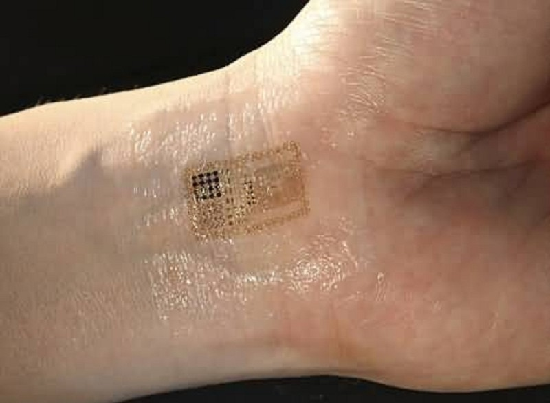 Nice Looking Golden Chip Tattoo On Wrist