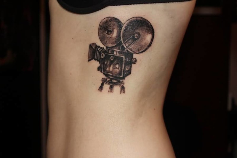 Nice Looking Small Cinema Film Tattoo Make On Rib Side