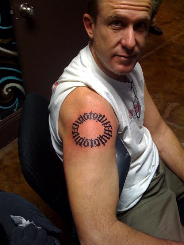 Old Men Show Amazing Circle Tattoo On Shoulder