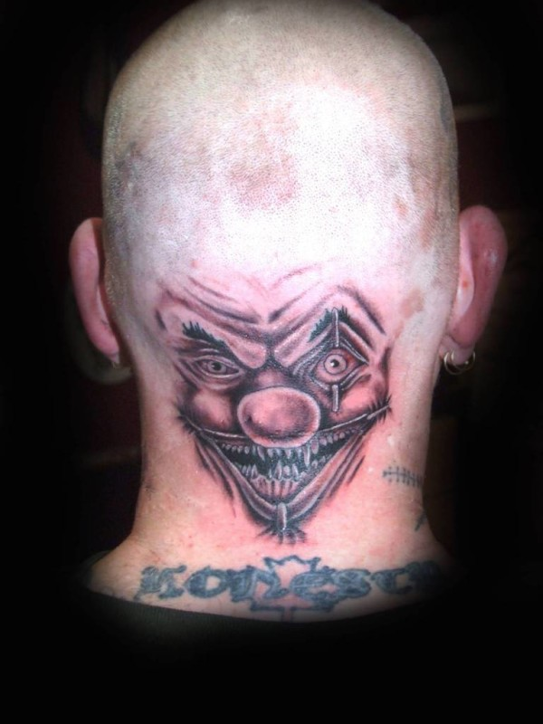 Outstanding Big Eyes Angry Clown Tattoo Design Make On Back Head