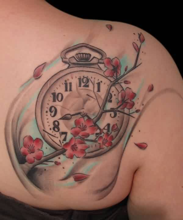 Pretty Women Show Old Clock And Lovely Flowers Tattoo On  Upper Back