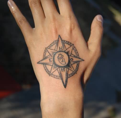 Pretty Women Show Outstanding Small Compass Tattoo On Hand
