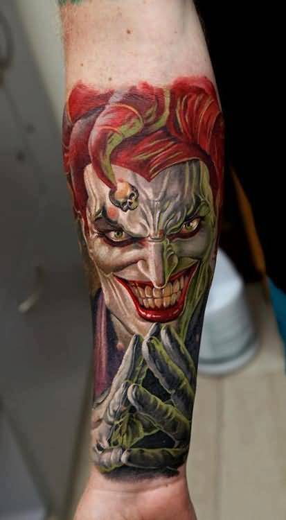 Tattoo Of Colorful  Angry Clown In Crazy Mood On Back Sleeve For Men