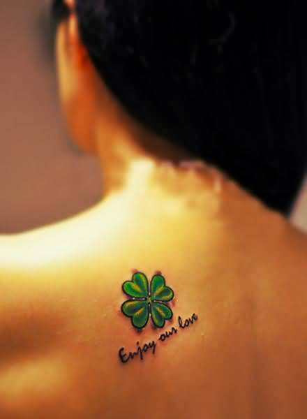 Upper Back Cover Up With Wonderful Green Clover And Nice One Enjoy Our Love Words Tattoo On Upper Bacl