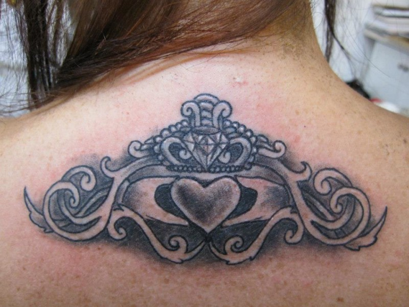 Upper Back Decorated With Brilliant  Claddagh Tattoo For Women