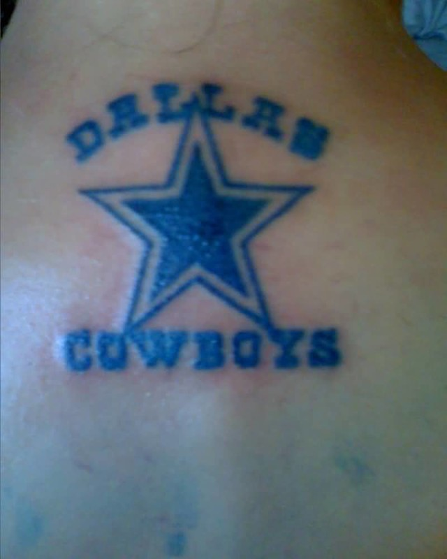 Upper Back Decorated With Dallas And Cowboy Word Tattoo Design For Men