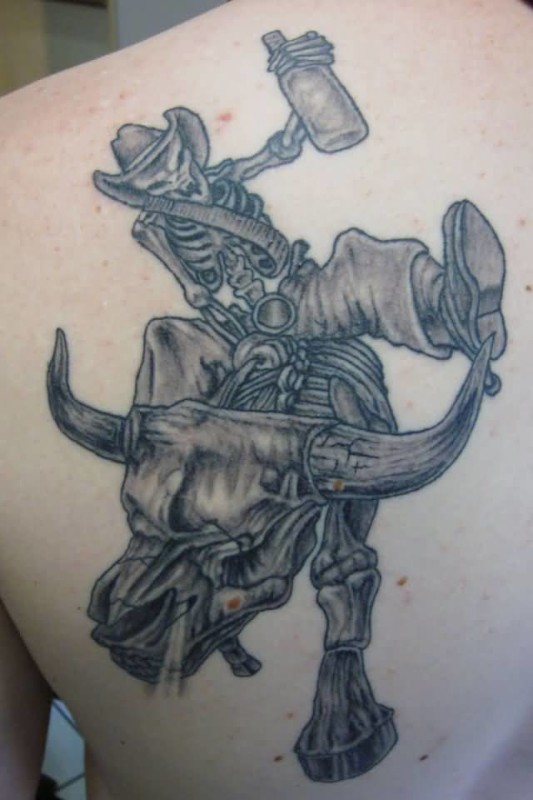 Weird Angry Cowboy Bull And Skull Tattoo Design Make On Upper Back