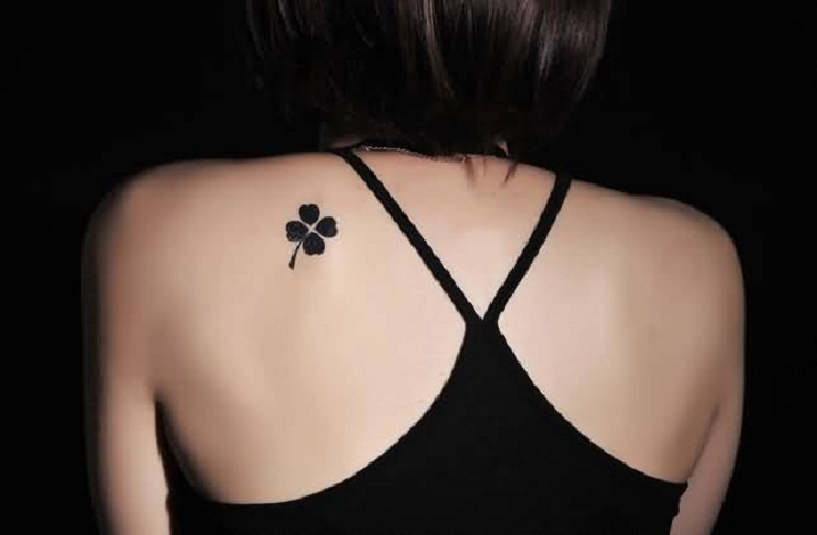 Wonderful Black Clover Tattoo Design Make On Upper Back