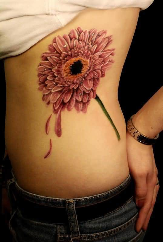 Awesome Daisy Flower Tattoo Design Make On Women's Rib Side