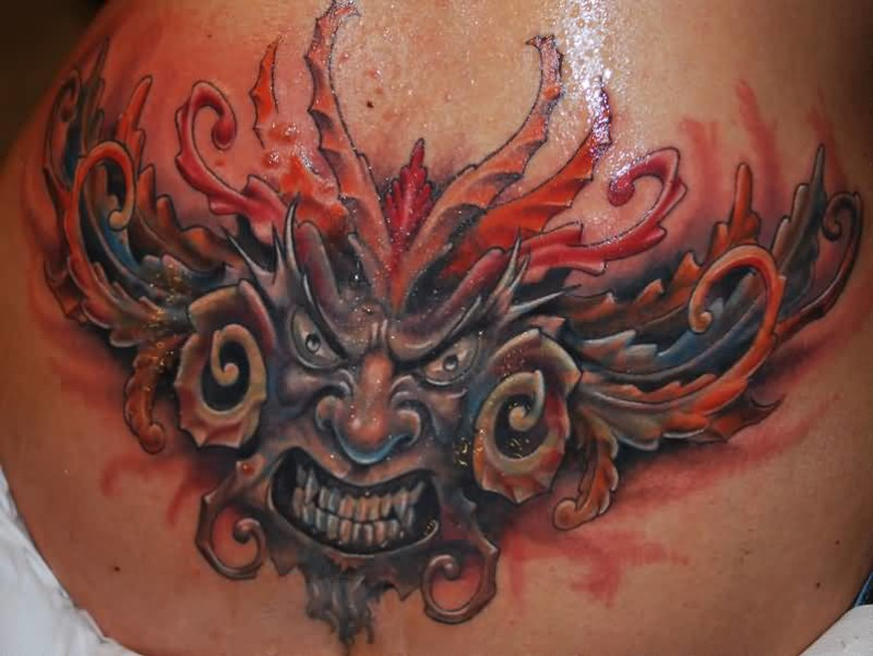Brilliant Glowing Scary Demon Face Tattoo Design For Hot Girl