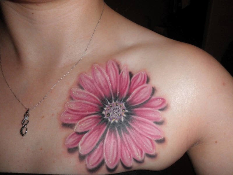 Brilliant Pink Color Daisy Flower Tattoo Design Make On Chest For Young Girl