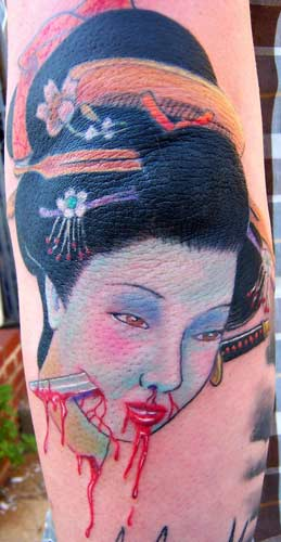 Dangerous Dagger In Beautiful Girl Face Tattoo Design