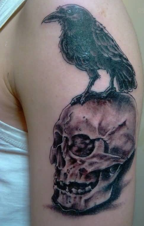 Dangerous Open Mouth Skull And Amazing Black Crow Tattoo On Upper Sleeve