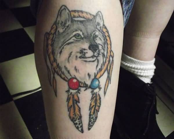 Fantastic Angry Wolf Animal In Dream Catcher Tattoo Design Make On Leg