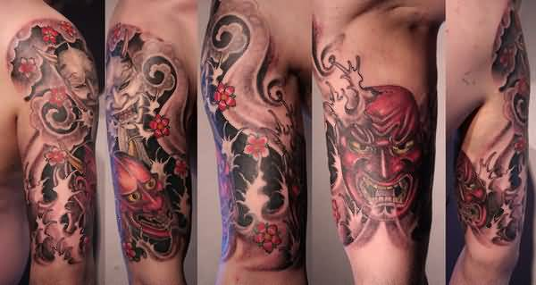 Fantastic Devil Face And Lovely Asian Flowers Tattoo On Men's Upper Sleeve